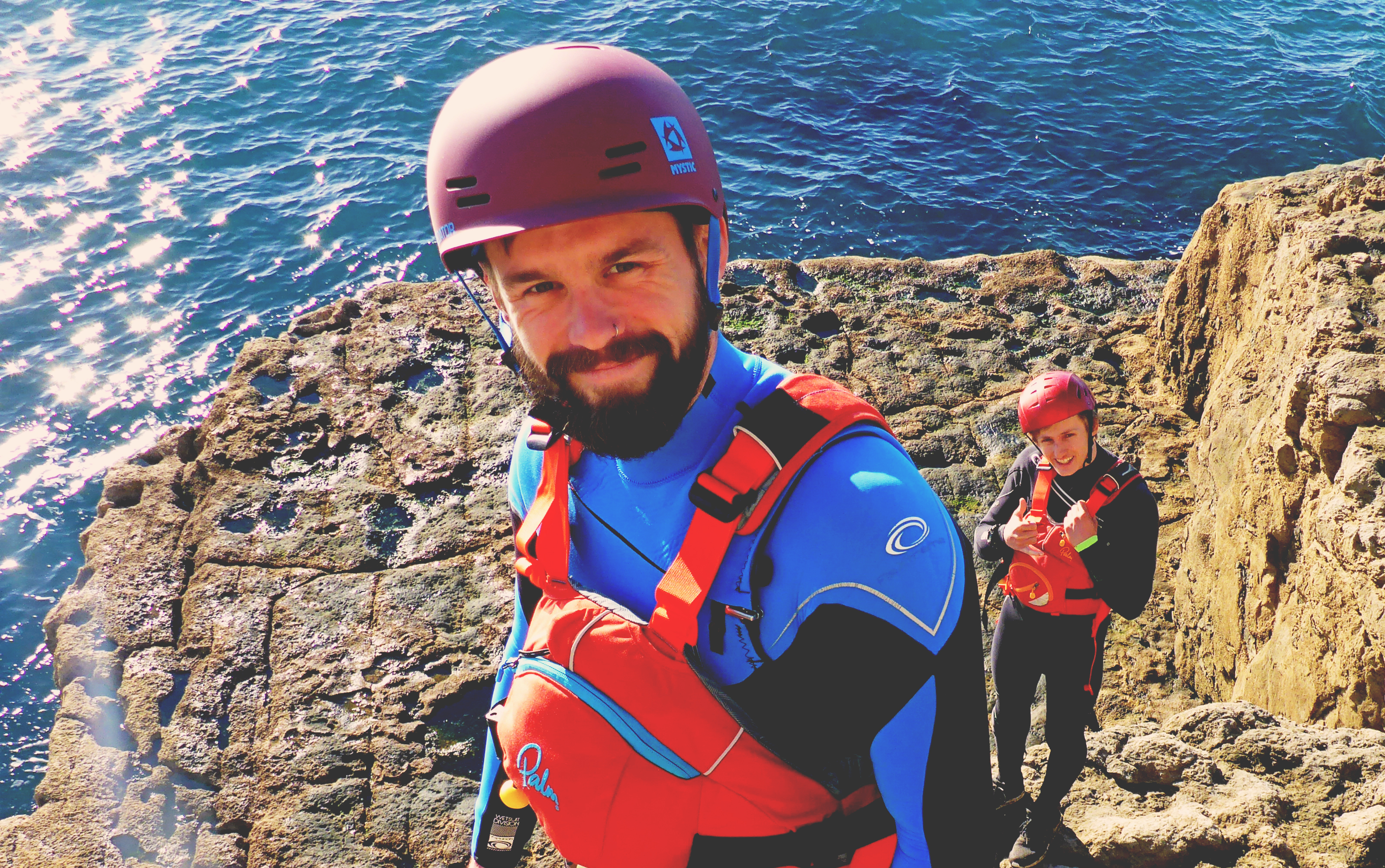 OIT. coasteering portrait male top of cliff