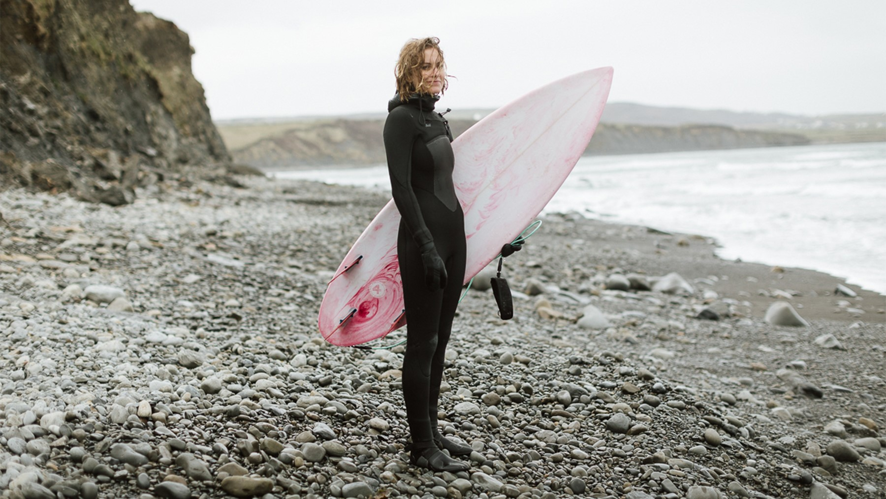 Sophie Hellyer Surf Simply Tom Shaw pink surfboard believe in equal pay fullwidth